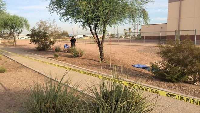 Phoenix police detectives investigate a body found near 35th Avenue and Lower Buckeye Road.