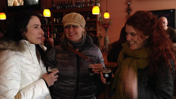 Jenise Fortunato, Anna Valeria-Iseman and Leah Stacy Waner try Naked Dove beer at Roam Cafe.