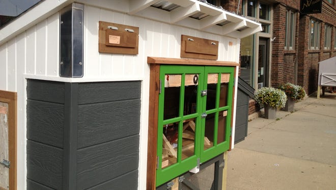 Chicken coops are on display along West 11th Street near Phillips Avenue.