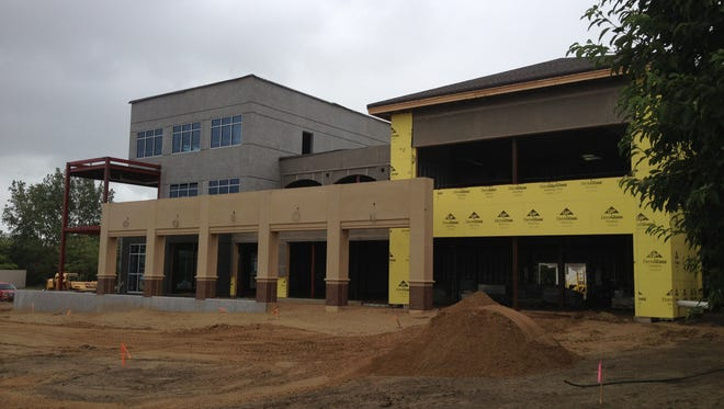 An addition at Plains Commerce Bank contributed to the city's second highest building permit total.