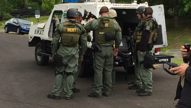 A sheriff's department SWAT team at the scene of a Verona standoff Tuesday morning.