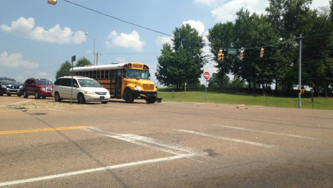 Damage can be seen to the front end of a school bus after it was involved in an accident with a car about 2 p.m. today. No children were on the bus. An ambulance was called because the driver of the car complained of back pain.