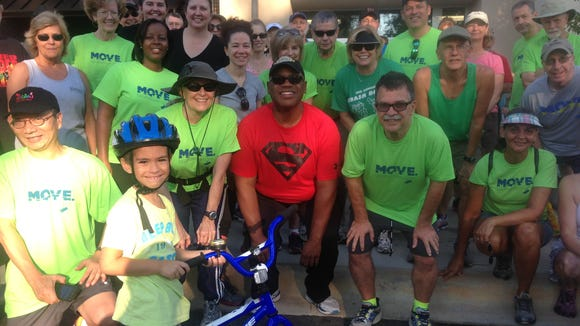 Some of the more than 40 walkers - and one bike rider - on hand last Saturday for the Move.Tallahassee.com walk at Sweat Therapy. Wearing the Superman shirt is Extreme Weight Loss celebrity Rod Durham. He put on a Move shirt after the walk.
