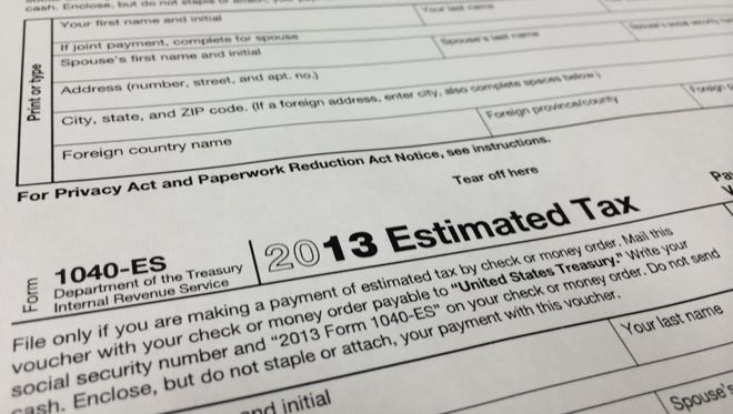 This Thursday, Jan. 9, 2013 photo, shows a 2013 1040-ES IRS Estimated Tax form at H & R Block tax preparation office in the Echo Park district of Los Angeles.