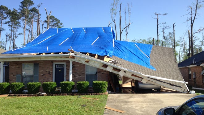 The tornado that hit tore a path through Rankin County, Miss., collapsed the home of Alicia Jenkins in the suburbs of Pearl near Brandon.