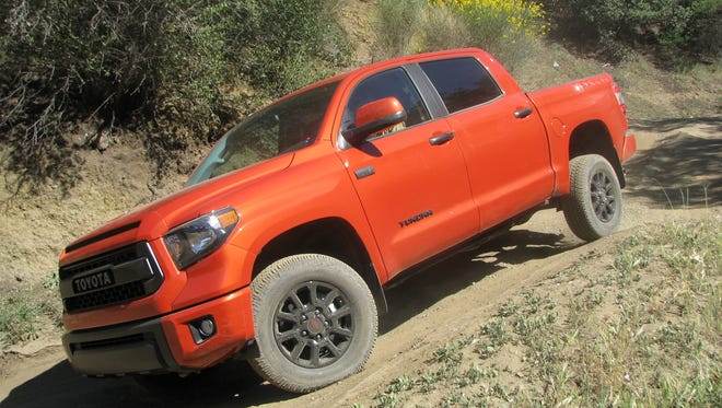 A Toyota TRD Pro Series pickup takes on a tough hill.