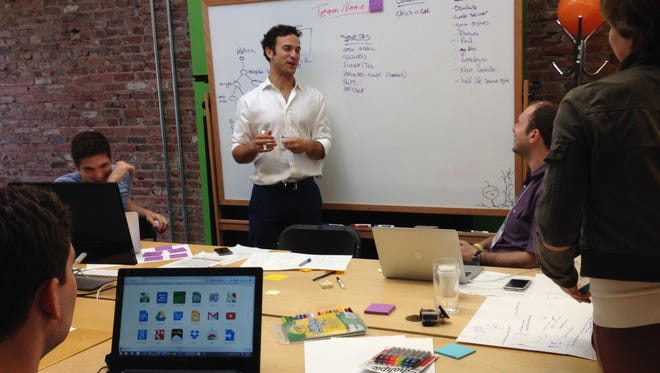 Members of Princeton University's EyeWire team discuss their proposed interactive neuroscience video game during the White House Game Jam held in Washington, D.C.