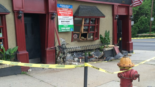 Damaged façade of 1064 McLean Avenue in Yonkers after a car hit it around 3 a.m. Tuesday, May 27.