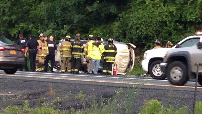 Police and firefighters at the scene where a vehicle overturned on Interstate 684 southbound Tuesday, July 8.