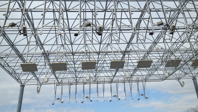 The E-ZPass electronic gantry for collection of truck tolls on the New York State Thruway in Spring Valley, seen in February. The Tappan Zee Bridge toll collection will go all-electronic in 2015 when a temporary gantry is placed in South Nyack. When the bridge opens in 2018, and a permanent toll plaza is relocated, all-electronic toll collection is expected to continue.  Peter Carr/The Journal News The EZPass gantry on the Thruway in Spring Valley Feb. 27, 2014.The windshield on James Sabolik's car broke when ice fell from the gantry.
