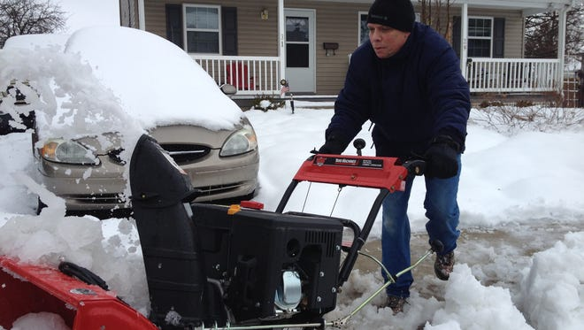 Jeff Barlow, 53, of Middletown, was using his snowblower to help plow out his neighbors.