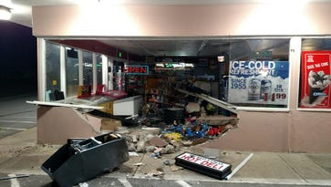 A truck crashed into a Brooks market, and its driver stole an ATM early Sunday morning.