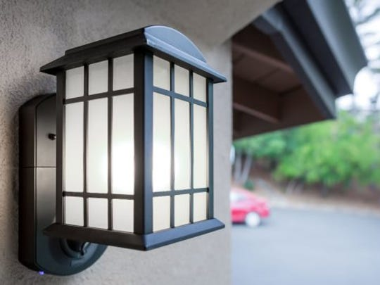 This smart porch light has a built-in security camera.
