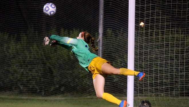Siegel's keeper Hayli Meeks deflects the ball preventing Brentwood from scoring a goal on Tuesday, Sept. 13, 2016. Siegel lost 2-0.