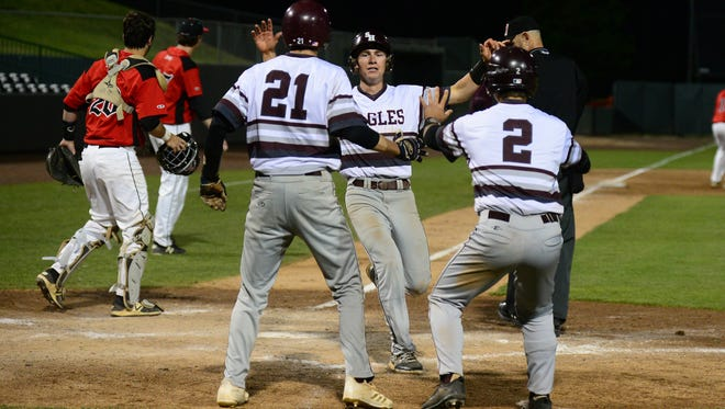 The Snow Hill Eagles celebrate after scoring two runs against Colonel Richardson during the Bayside Conference Championship game on Tuesday, May 8, 2018 at the Arthur W. Perdue Stadium in Salisbury, Md.