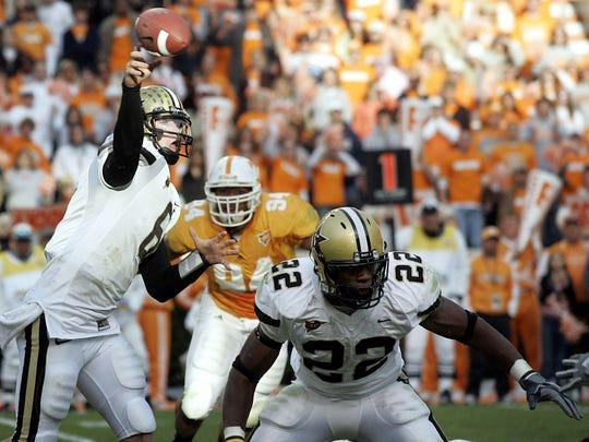 Vanderbilt quarterback Jay Cutler (6) throws the winning touchdown in the closing minutes of play against Tennessee as Cassen Jackson-Garrison (22) protects Cutler. Vanderbilt won 28-24 at Neyland Stadium Nov. 19, 2005.