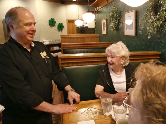 Jim Romano, owner, visits with longtime customers Joyce Madonia of Ogden, center, and Janet Northrup of Greece, right, at his Keenan's Restaurant in Irondequoit Wednesday, June 21, 2017.  After 31 years in Irondequoit, the popular family restaurant is closing.