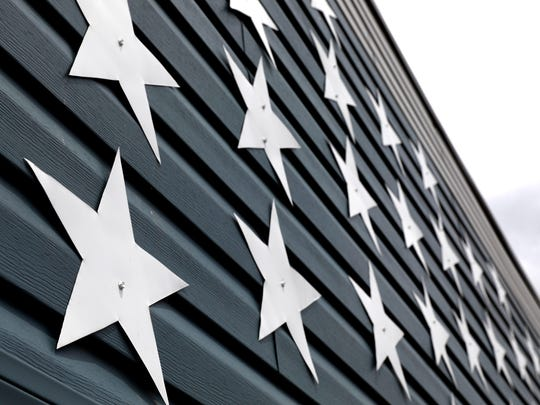 Stars were hand cut from metal used to make gutters