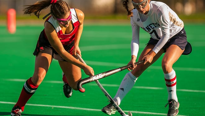 CVU #1 Lydia Maitland get a stick on the ball over Essex #7 Hannah Palmer during their semi-final match up at UVM on Monday, Oct. 30, 2017. CVU pulled out the win, 2-1.