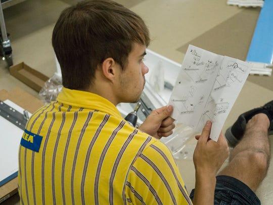 Scott Anderson reads IKEA instructions.