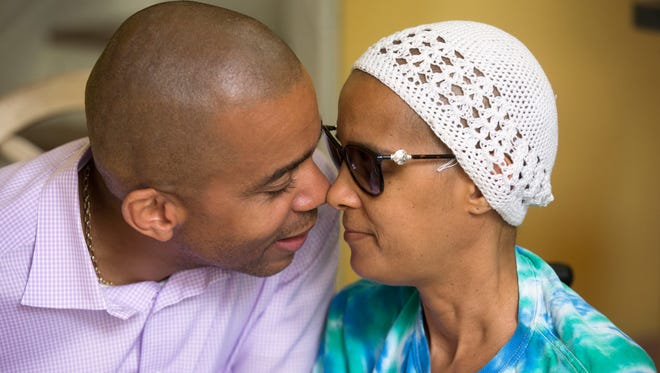 Christopher Smitherman, 50, shares an intimate moment with his wife of nearly 27 years, Pamela, 46. In January, Pamela started to not feel well, noticing first she was losing function in her leg. By March, they knew her breasts were consumed with cancer and her own antibodies were attacking her brain. She now needs round-the-clock care. She struggles with speech, coordination and vision problems. For now, Smitherman does most of the care himself, with the help of his mom. The couple will celebrate 27 years of marriage in December. They have five kids, ranging in age from 21 to nine. Smitherman is a member of the Cincinnati City Council. He is running for re-election. Pamela was a long-term substitute teacher in the Cincinnati Public School system for 21 years.