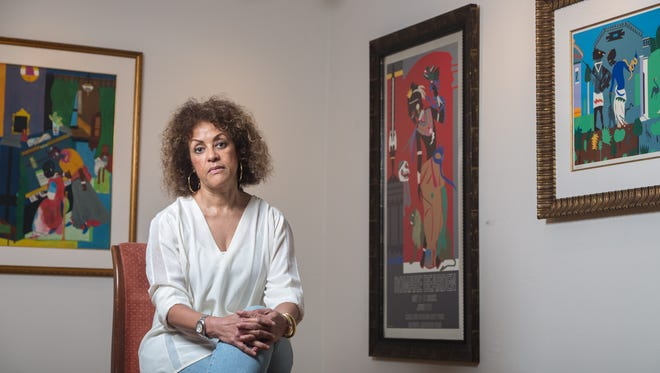 Dr. Celeste Hart in the Anderson-Brickler Gallery, featuring her collection of Romare Bearden's work.
