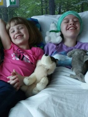In a photo released on Abigail Kopf's GoFundMe page, the Kalamazoo shooting victim, right, laughs with her sister Juliana Kopf.