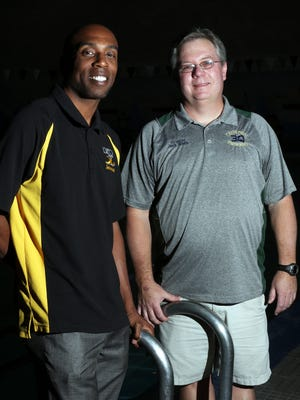 Wright Stanton, left, of Loretto and Jack White of Cathedral are the prep swimming Coaches of Year.