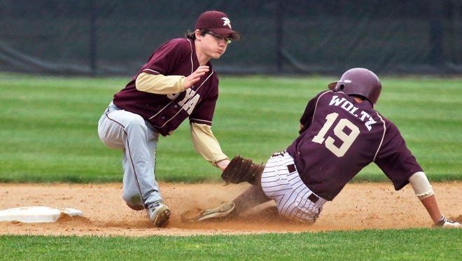 Royalton's Michael Petron tags Chatfield's Ethan Woltz out on an attempted steal Thursday. Chatfield won, 6-3.