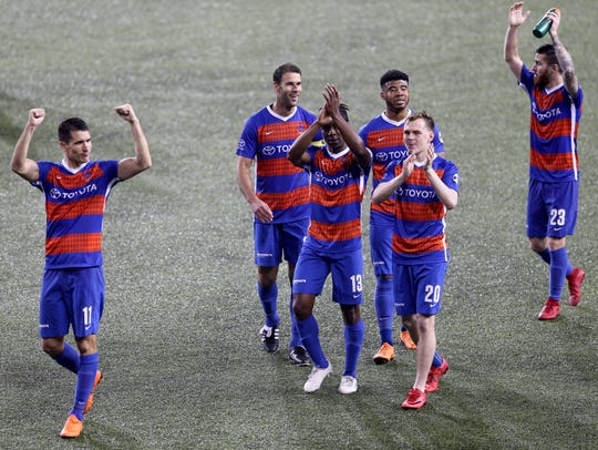 From left: FC Cincinnati forward Danni Kšonig (11), FC Cincinnati midfielder Dekel Keinan (21), midfielder Michael Lahoud (13), midfielder Emery Welshman (10), midfielder Jimmy McLaughlin (20) and defender Blake Smith (23) acknowledge the fans after the 4-2 win against Atlanta United 2 and FC Cincinnati, Saturday, May 5, 2018, at Nippert Stadium in Cincinnati. FC Cincinnati won 4-2.