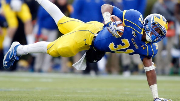 Delaware running back Wes Hills falls as he is tripped
