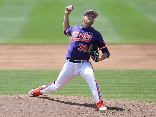 Clemson senior Clate Schmidt delivers against Florida State Sunday afternoon at Doug Kingsmore Stadium.