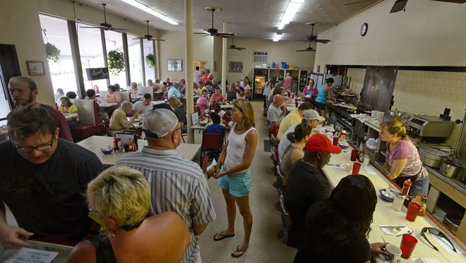 Diners have breakfast Saturday morning at the Coffee Cup on Cervantes St.