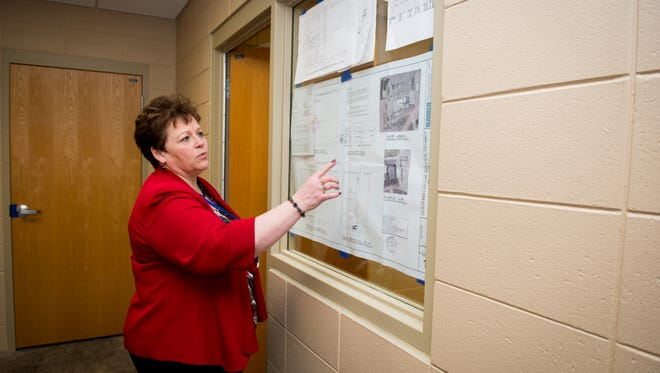 Southern Door Superintendent Patti Vickman goes through the floor plan for the Southern Door Community Clinic. Ministry Door County Medical Center is renovating an area of the school building to include an exam room, storage and a lab, a private entrance with seating, a bathroom, and a reception area. The clinic is expected to open Feb. 15.