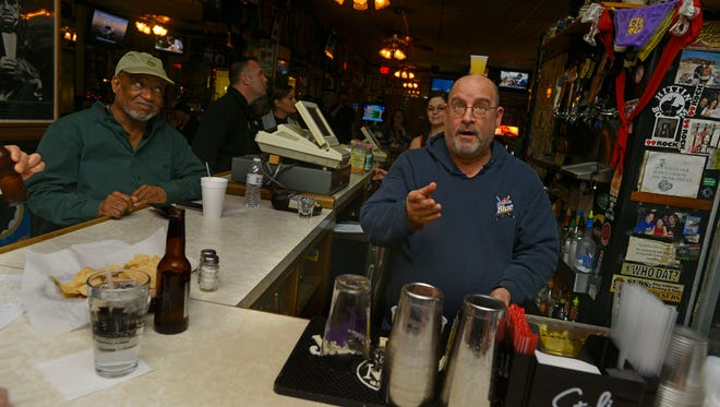 Nick Zangari, owner of  New York Nick's in downtown Pensacola, works the bar Sunday before the Super Bowl.