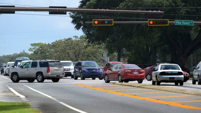 Traffic moves east on Nine Mile Rd. near Pine Forest Rd. The Florida Department of Transportation will begin a two-year, $46 million project of widening a section of the highway between Escambia and Santa Rosa counties in Sept.