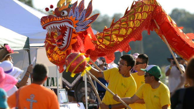 Members of the Confucius Institute perform a dragon dance during the 2016 Pensacola Dragon Boat Race and Festival at Bayview Park.