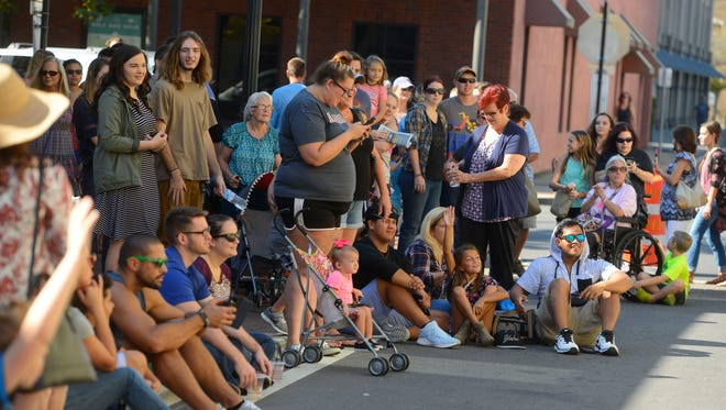 The crowd watches Stephen McCrory perform during the Umbrella Sky Festival as part of a past Foo Foo Festival.