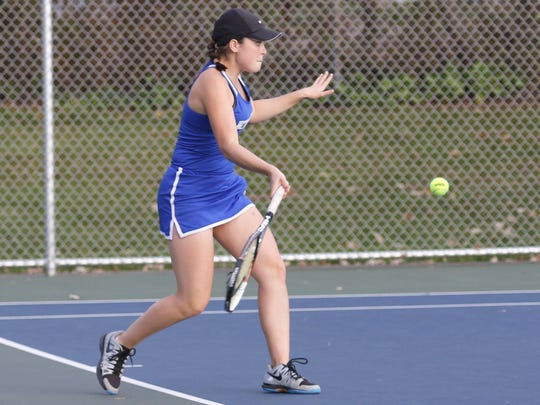 Meredith Braiman of Horseheads returns a shot during her victory at No. 2 singles Tuesday during the STAC tournament final at Horseheads. Binghamton Seton Catholic Central won, 4-3.