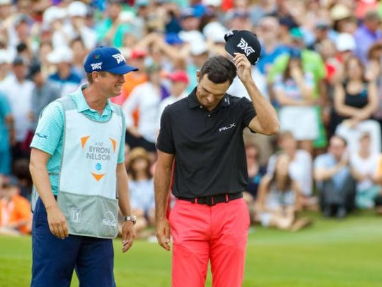 Billy Horschel reacts with his caddy Josh Cassell after