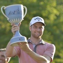 Sep 1, 2014; Norton, MA, USA; Chris Kirk hold the Deutsche Bank Championship trophy after winning the final round at TPC of Boston. Mandatory Credit: Mark Konezny-USA TODAY Sports
