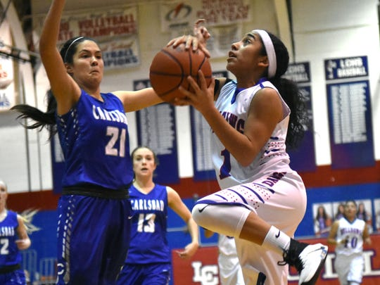 Las Cruces High's Brooke Salmon for the Bulldawgs goes up for a lay up last night against Carlsbad in district action.