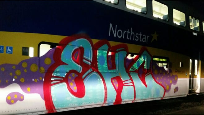A parked Northstar rail car was tagged by graffiti spray paint.