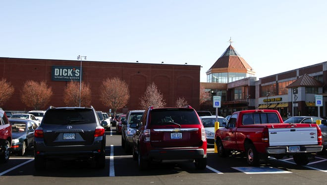Cars occupy the parking lot at Oxmoor Mall.