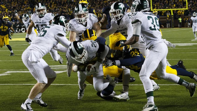 Jalen Watts-Jackson (20) dives into the end zone as the clock expires to beat Michigan last Oct. 17. Watts-Jackson suffered a broken hip on the play. Now an MSU legend and just a sophomore, he's facing life as just another safety battling for playing time.