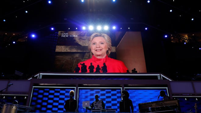 Democratic Presidential candidate Hillary Clinton appears on the screen during the second day session of the Democratic National Convention in Philadelphia, Tuesday, July 26, 2016. Photo/Carolyn Kaster