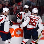 Sep 28, 2014; Montreal, Quebec, CAN; Washington Capitals forward Joel Ward (42) celebrates with teammates Karl Alzner (27) and Andre Burakovsky (42) after scoring a goal against the Montreal Canadiens during the third period at the Bell Centre. Mandatory Credit: Eric Bolte-USA TODAY Sports