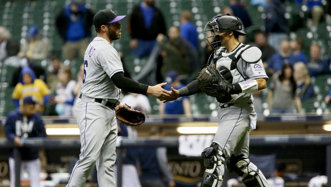 Greg Holland (left) and Tony Wolters celebrate Tuesday's victory.