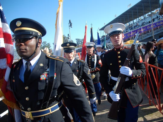 The color guard enters the track area for Friday night's Grand Entry at the 102nd California Rodeo Salinas.