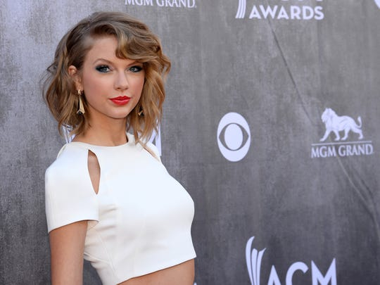 Taylor Swift wears a crop top to the 49th annual Academy of Country Music Awards. Crop tops are an easy way to keep cool while maintaining an edge in your outfit.